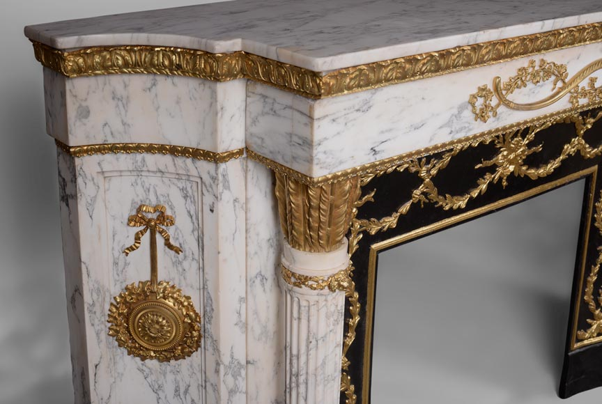 Very beautiful antique Louis XVI style fireplace in Arabescato marble with quiver-shaped columns, gilt bronze ornaments and curved sides after the model from the Chateau of Fontainebleau-4