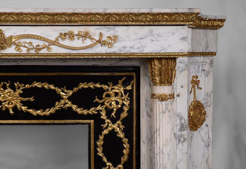 Very beautiful antique Louis XVI style fireplace in Arabescato marble with quiver-shaped columns, gilt bronze ornaments and curved sides after the model from the Chateau of Fontainebleau-8