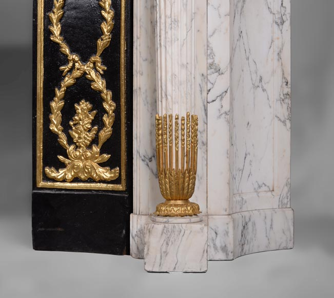 Very beautiful antique Louis XVI style fireplace in Arabescato marble with quiver-shaped columns, gilt bronze ornaments and curved sides after the model from the Chateau of Fontainebleau-9