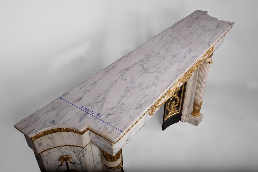 Very beautiful antique Louis XVI style fireplace in Arabescato marble with quiver-shaped columns, gilt bronze ornaments and curved sides after the model from the Chateau of Fontainebleau-12