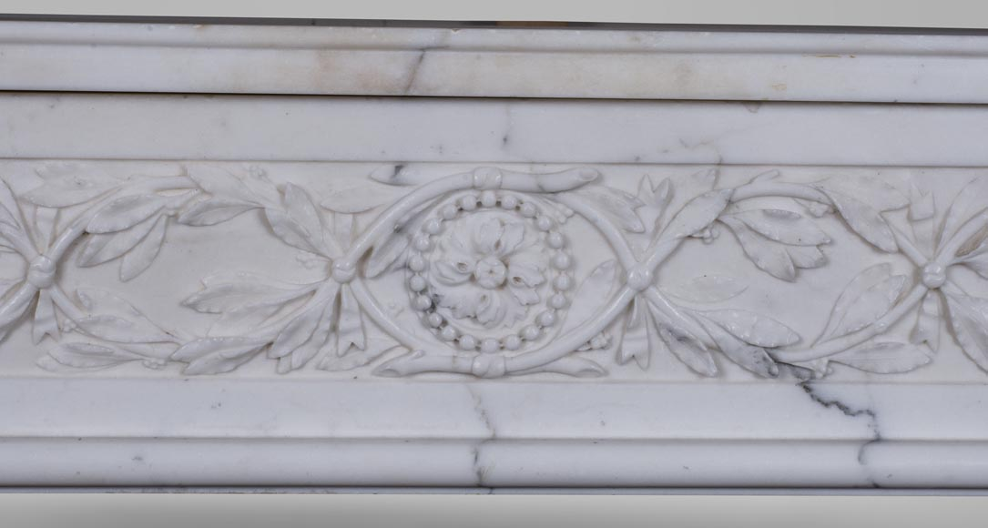 An antique Louis XVI style fireplace, made out of semi-statuary marble-1