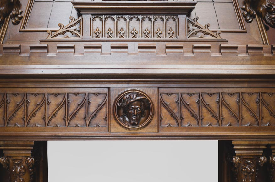 Beautiful antique Neo-Gothic style fireplace in sculpted walnut with hood, representing St Michael slaying the demon-4