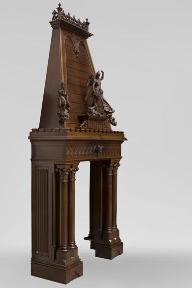 Beautiful antique Neo-Gothic style fireplace in sculpted walnut with hood, representing St Michael slaying the demon-6