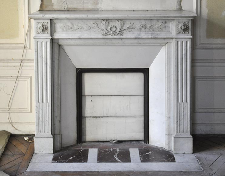 Charming antique Louis XVI style fireplace in Carrara marble with fluted pilasters and entablature carved of laurel branches - Reference 3260