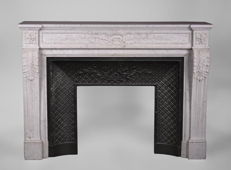 Beautiful antique Louis XVI style fireplace in Carrara marble, carved decor of laurel branches and acanthus leaves - Reference 3264