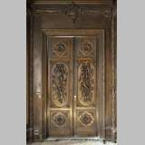 Large antique carved oak wood paneled room with hunting trophies and still lifes decor