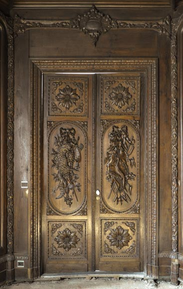 Large antique carved oak wood paneled room with hunting trophies and still lifes decor-0
