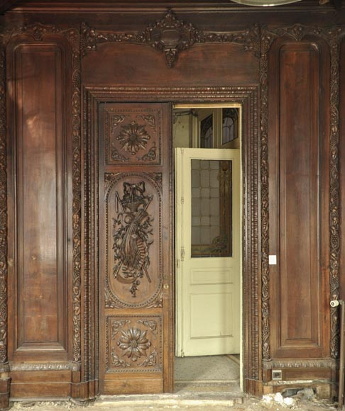 Large antique carved oak wood paneled room with hunting trophies and still lifes decor-1