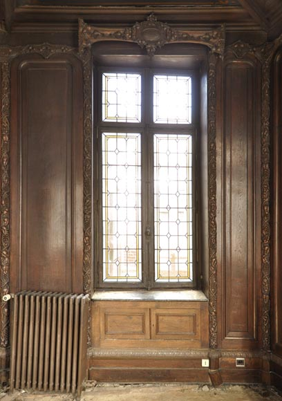 Large antique carved oak wood paneled room with hunting trophies and still lifes decor-2