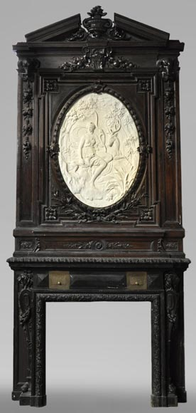 Antique wooden and stucco fireplace with large medallion featuring Diana the Huntress-0