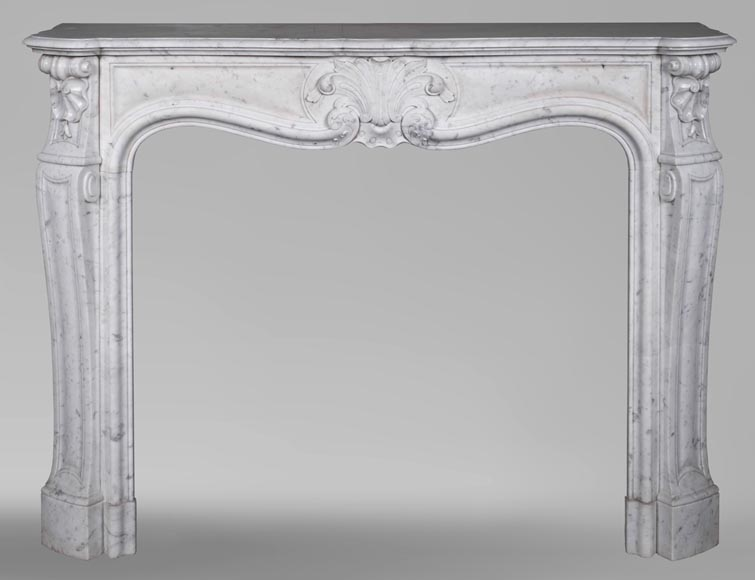 An antique Louis XV style fireplace with foliaged shell-0