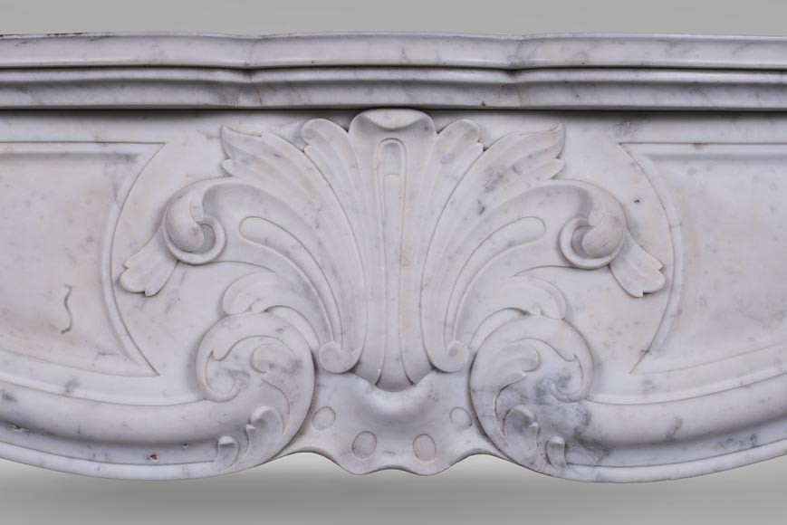 An antique Louis XV style fireplace with foliaged shell-1