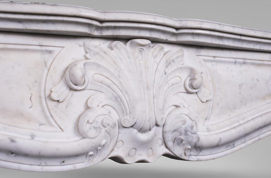An antique Louis XV style fireplace with foliaged shell-2