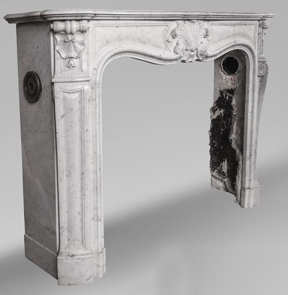 An antique Louis XV style fireplace with foliaged shell-3