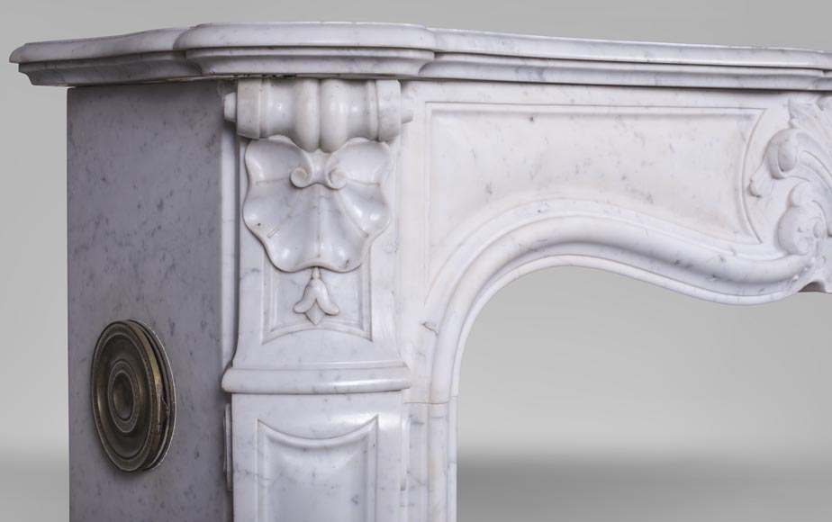 An antique Louis XV style fireplace with foliaged shell-4