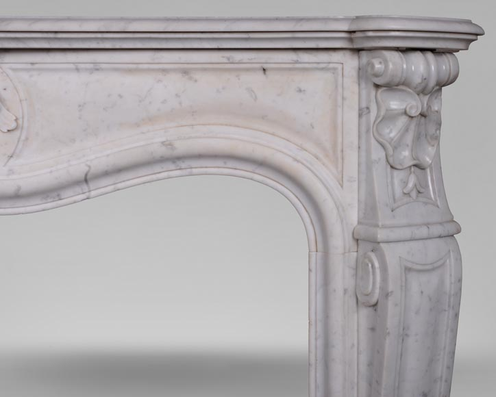 An antique Louis XV style fireplace with foliaged shell-6