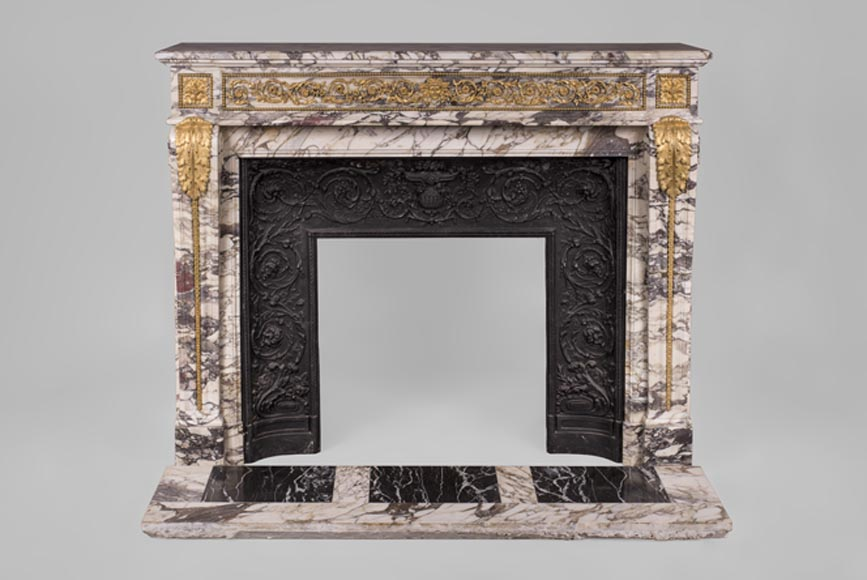 Very beautiful antique Louis XVI style fireplace in Violet Breccia marble with gilt bronze ornaments - Reference 3374