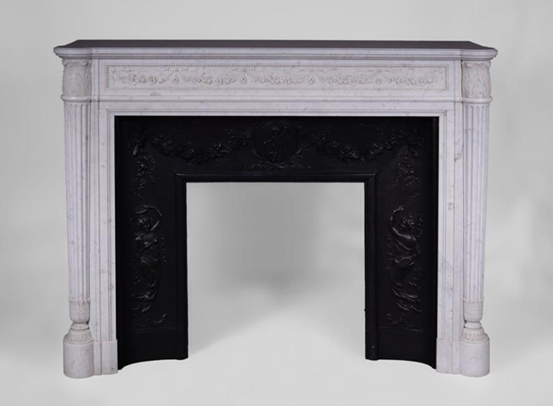 Beautiful antique Louis XVI style fireplace with fluted half-columns and frieze of garlands of flowers in Carrara marble - Reference 3386