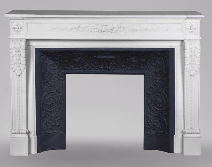 An antique Louis XVI style fireplace made out of Carrara marble with Cupid's attributes-0