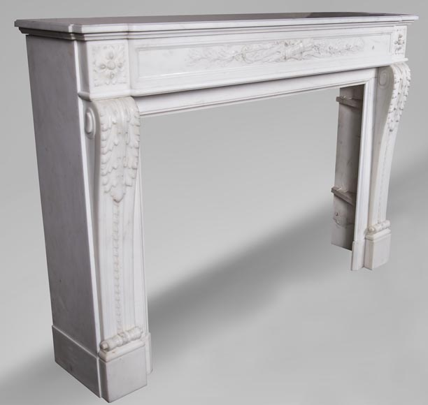 An antique Louis XVI style fireplace made out of Carrara marble with Cupid's attributes-2