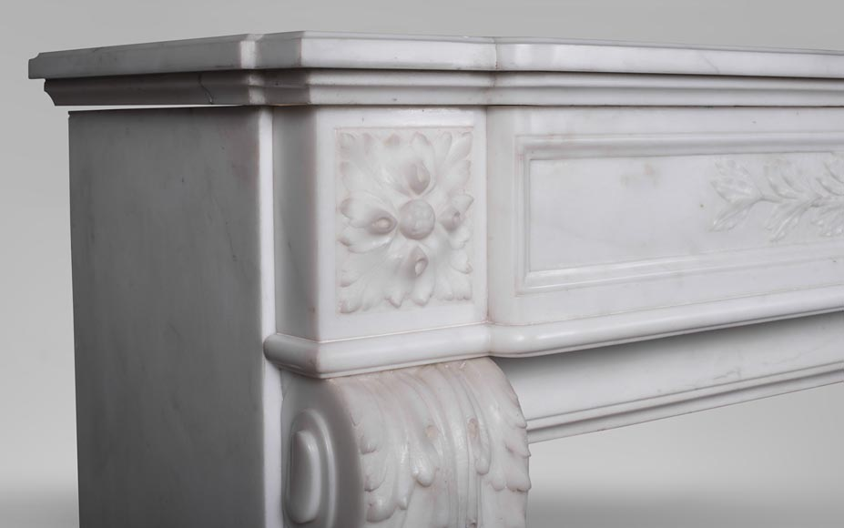 An antique Louis XVI style fireplace made out of Carrara marble with Cupid's attributes-3