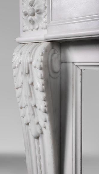 An antique Louis XVI style fireplace made out of Carrara marble with Cupid's attributes-4