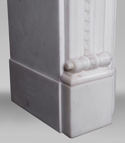 An antique Louis XVI style fireplace made out of Carrara marble with Cupid's attributes-5