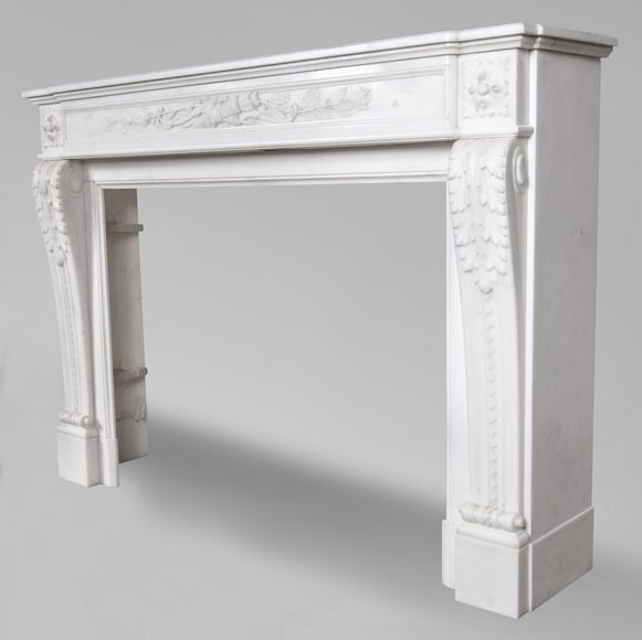An antique Louis XVI style fireplace made out of Carrara marble with Cupid's attributes-6
