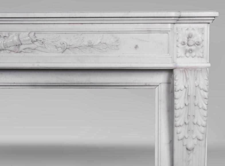 An antique Louis XVI style fireplace made out of Carrara marble with Cupid's attributes-7
