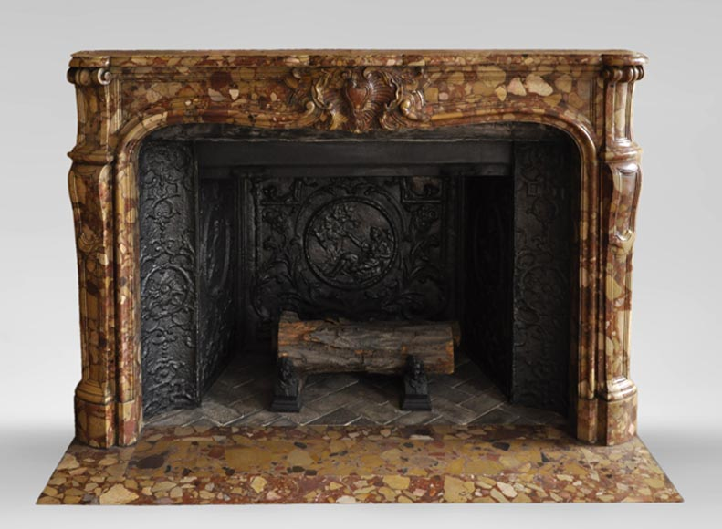 Beautiful antique Louis XV style fireplace in Aleppo Breccia marble with a large shell-0