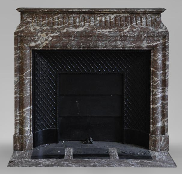 Antique Louis XIV style fireplace in Red from the North marble with acroterion and