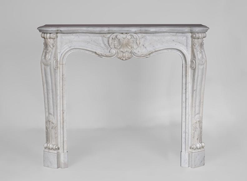 Beautiful antique Louis XV style fireplace in Carrara marble with foliate shell - Reference 3509
