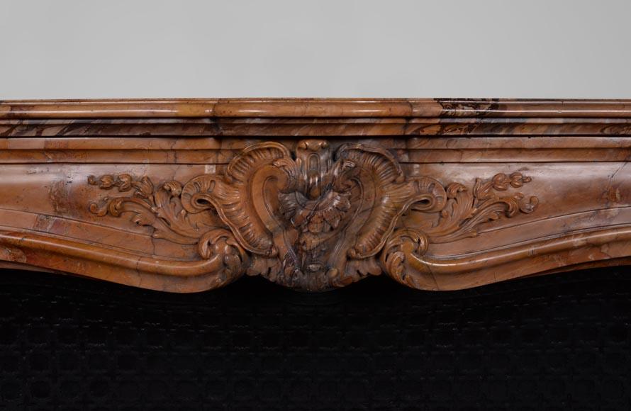 Beautiful antique Louis XV style fireplace made out of Sienna Brocatelle marble, richly carved-1