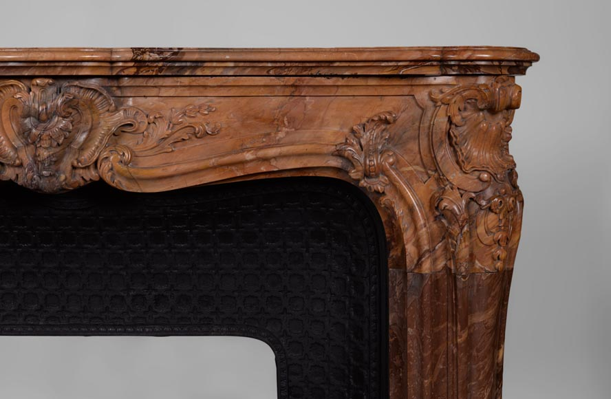 Beautiful antique Louis XV style fireplace made out of Sienna Brocatelle marble, richly carved-10