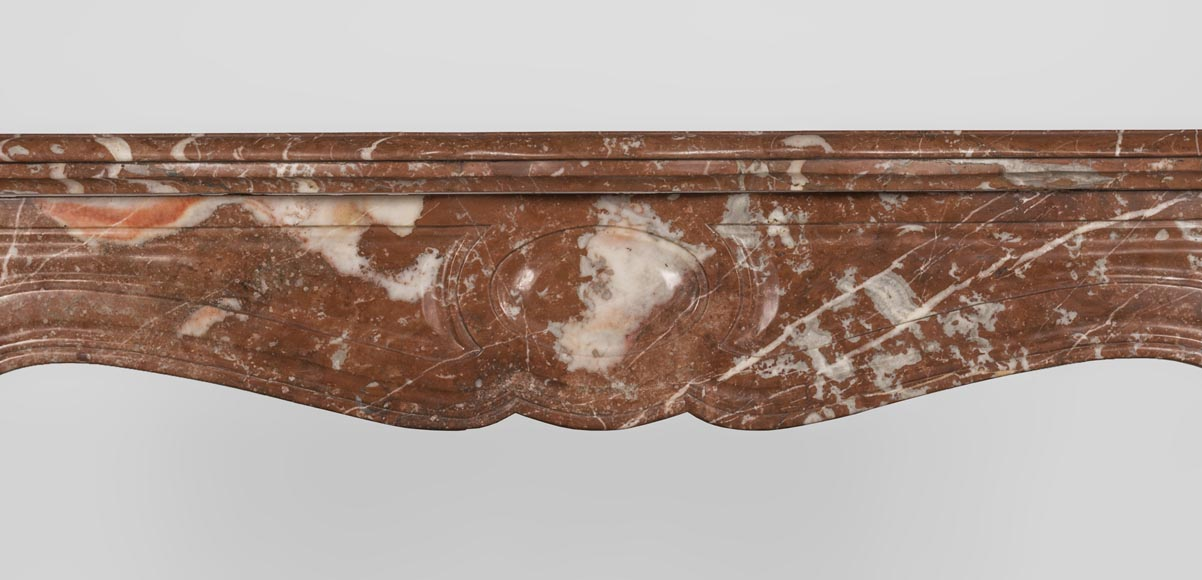 An antique Louis XV style fireplace made out of Rouge du Nord marble-1