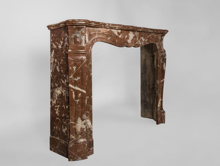 An antique Louis XV style fireplace, Pompadour model, made out of Rouge du Nord marble-3