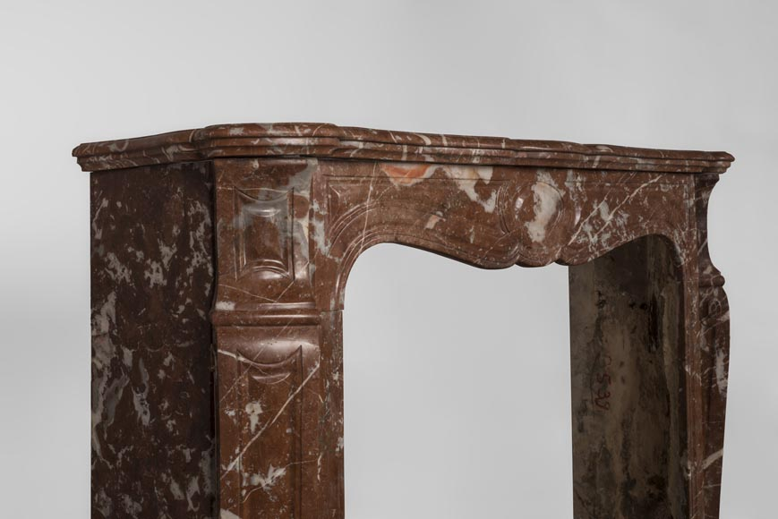 An antique Louis XV style fireplace, Pompadour model, made out of Rouge du Nord marble-4
