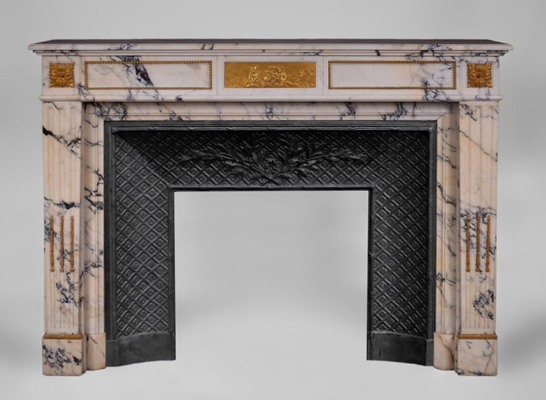 Antique Louis XVI style fireplace in Paonazzo marble with bronze ornaments and putti - Reference 3546