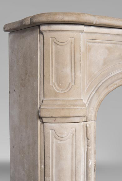 An antique Louis XV style fireplace, made out of stone, with large asymmetrical shell-4