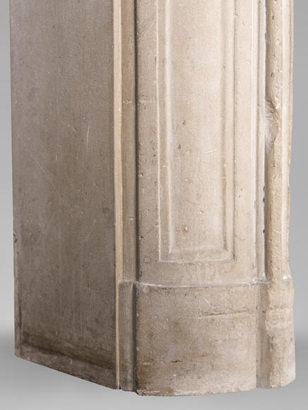 An antique Louis XV style fireplace, made out of stone, with large asymmetrical shell-5