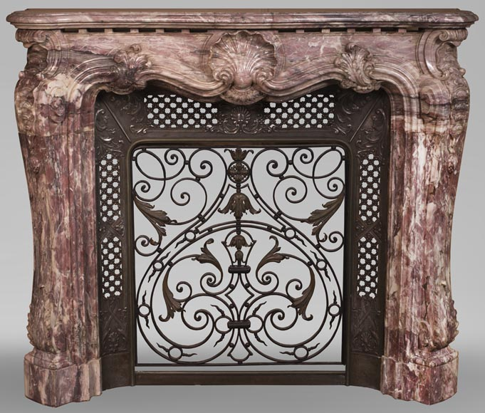 Very beautiful antique Louis XV style opulent fireplace made out of Fleur de Pêcher marble - Reference 3630