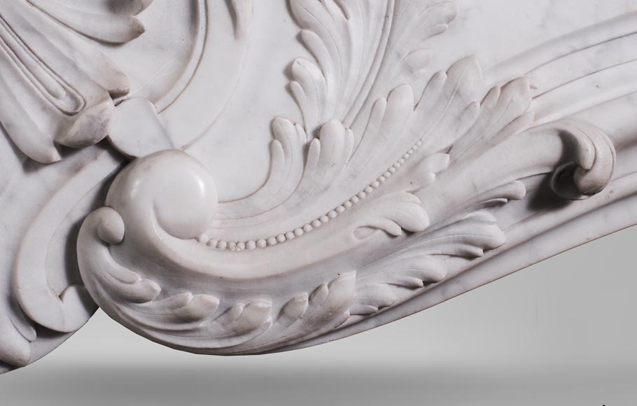 Antique Louis XV style fireplace mantel, made out of richly carved veined Carrara marble-4