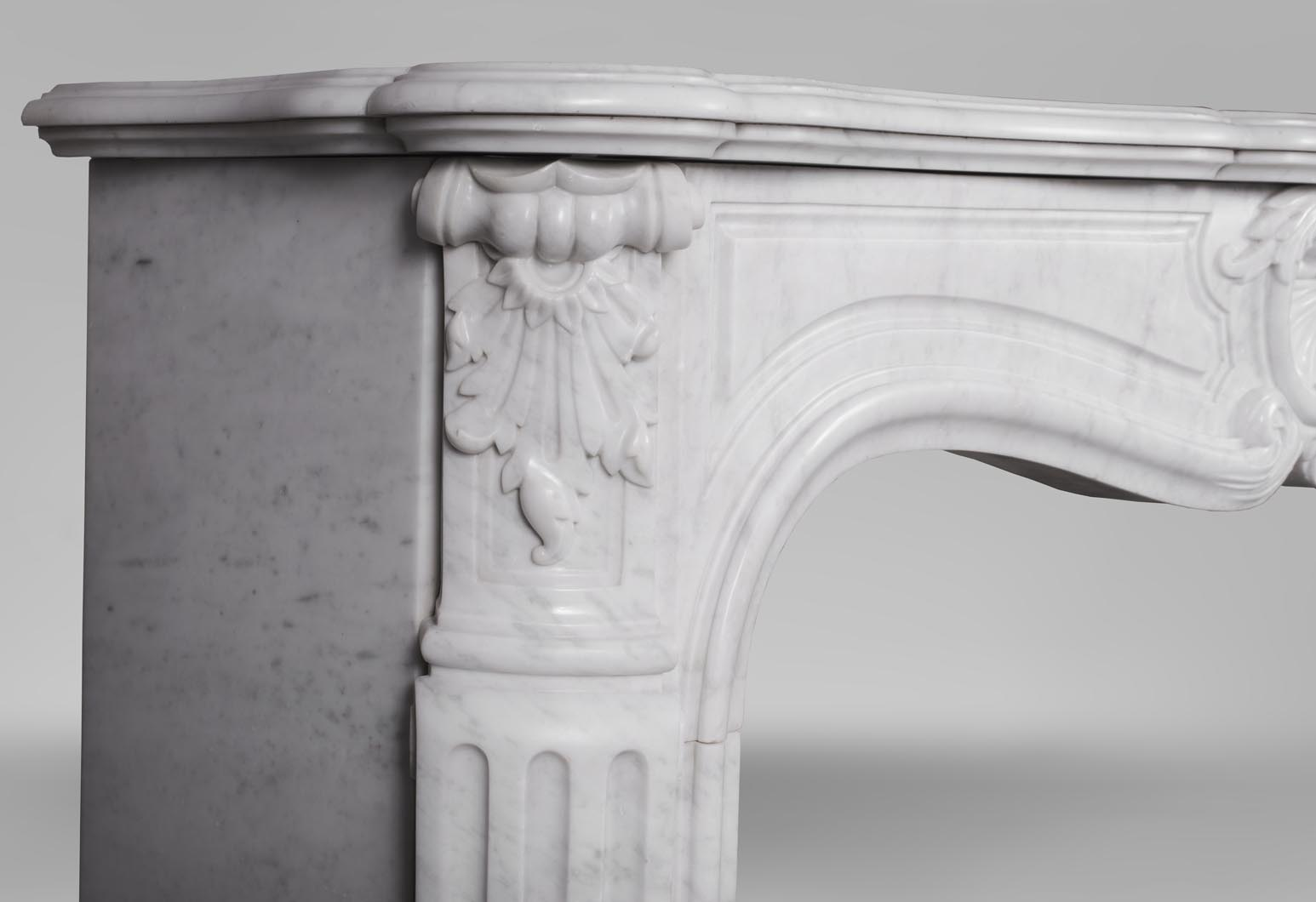 An antique Louis XV style fireplace, made out of Carrara marble-4