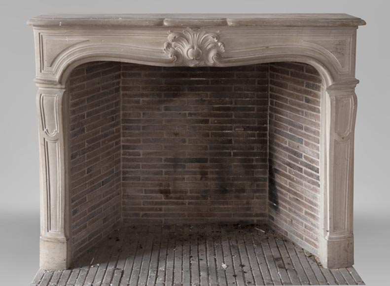 Beautiful antique Louis XV style fireplace in stone decorated with a palmette - Reference 3646