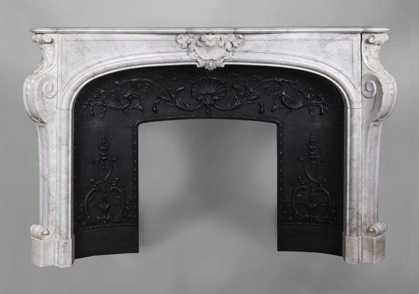 An antique Louis XV style fireplace, made out of Carrara marble, with shell décoration-0