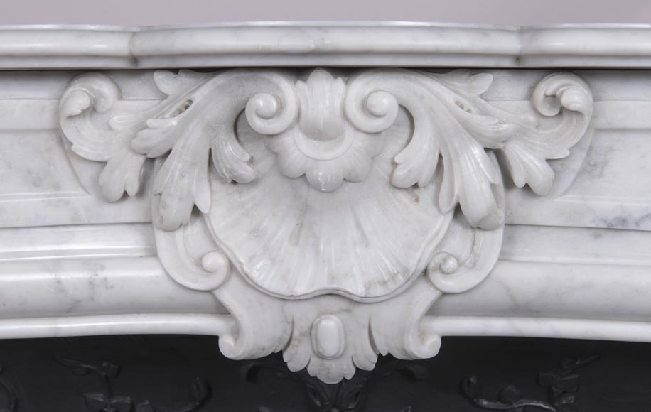An antique Louis XV style fireplace, made out of Carrara marble, with shell décoration-1