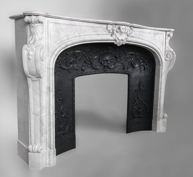 An antique Louis XV style fireplace, made out of Carrara marble, with shell décoration-2
