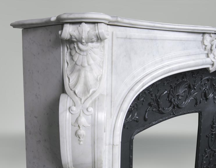 An antique Louis XV style fireplace, made out of Carrara marble, with shell décoration-3