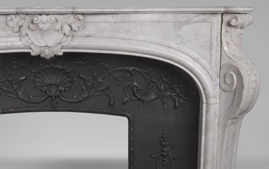 An antique Louis XV style fireplace, made out of Carrara marble, with shell décoration-6