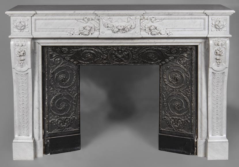 An antique Louis XVI style fireplace, made out of Carrara marble, entablature richly carved with garland of flowers-0